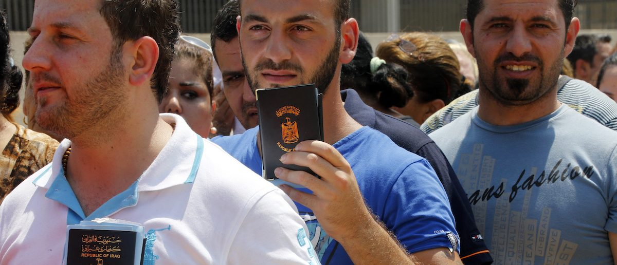 Iraqi Christians displaced by the violence in their country wait in line to receive aid from a Chaldean Catholic Church truck in Beirut August 13, 2014. Well financed and armed, Islamic State insurgents have captured large swathes of territory in a summer offensive, as the Iraqi army - and now Kurdish Peshmerga forces in the self-governing north - have crumbled in the face of its onslaught, massacring Shi'ites and minority Christians and Yazidis as they advance.  REUTERS/Mohamed Azakir (LEBANON - Tags: POLITICS CIVIL UNREST RELIGION SOCIETY) - RTR42A5W