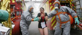 Firemen wearing chemical protective suits take part in a mock chemical attack exercise. REUTERS/Robert Pratta
