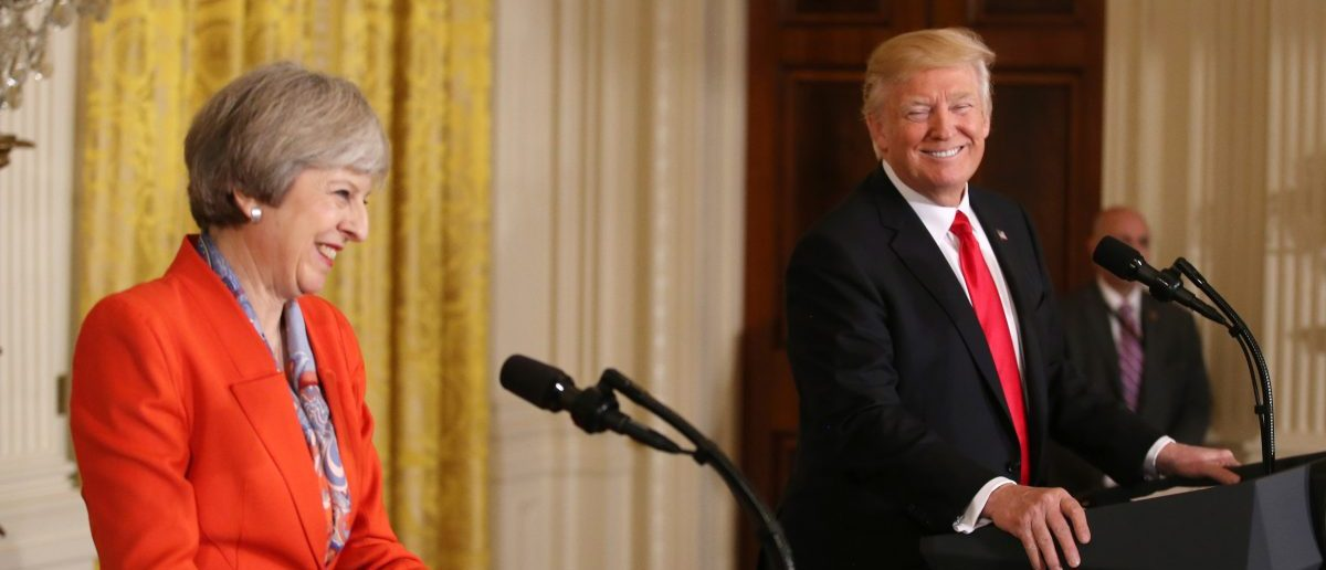 U.S. President Donald Trump and British Prime Minister Theresa May smile as they hold a joint news conference at the White House in Washington, U.S., January 27, 2017.    REUTERS/Carlos Barria