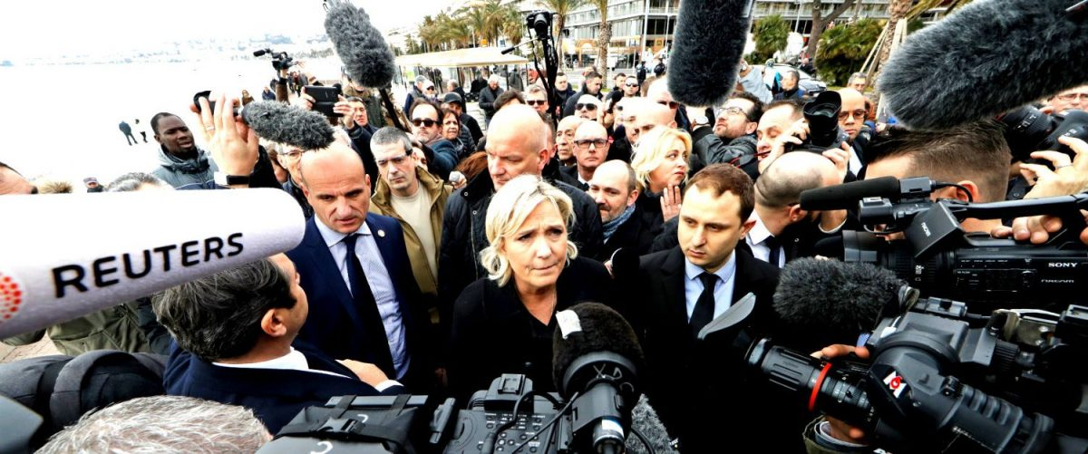 French National Front leader Marine Le Pen and presidential election candidate (C) talks to the media on the Promenade des Anglais, in Nice, France, February 13, 2017. REUTERS/Eric Gaillard