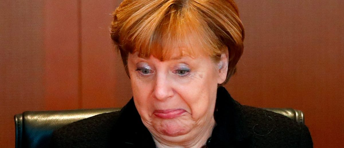 German Chancellor Merkel reacts during a cabinet meeting at the Chancellery in Berlin