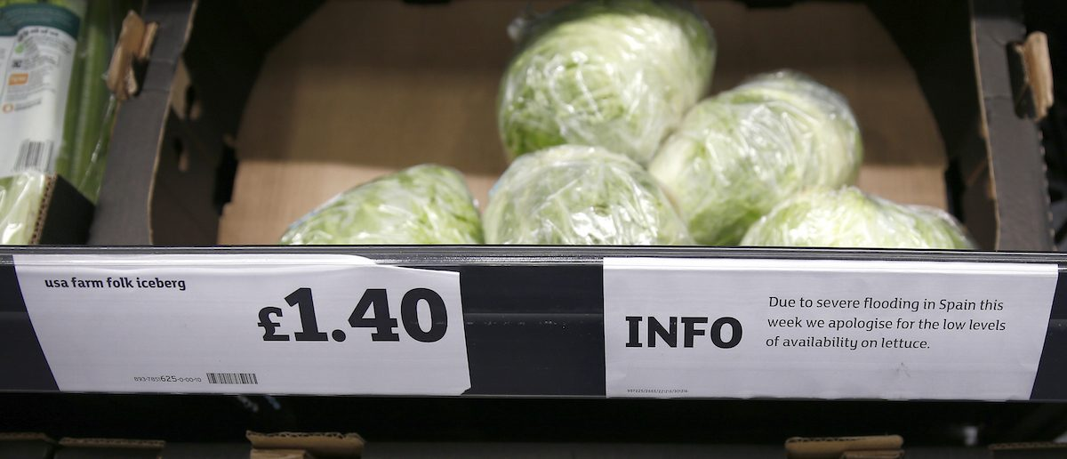 Iceberg lettuces are seen next to a sign explaining their short supply in a supermarket, in London (Photo: REUTERS/Peter Nicholls)
