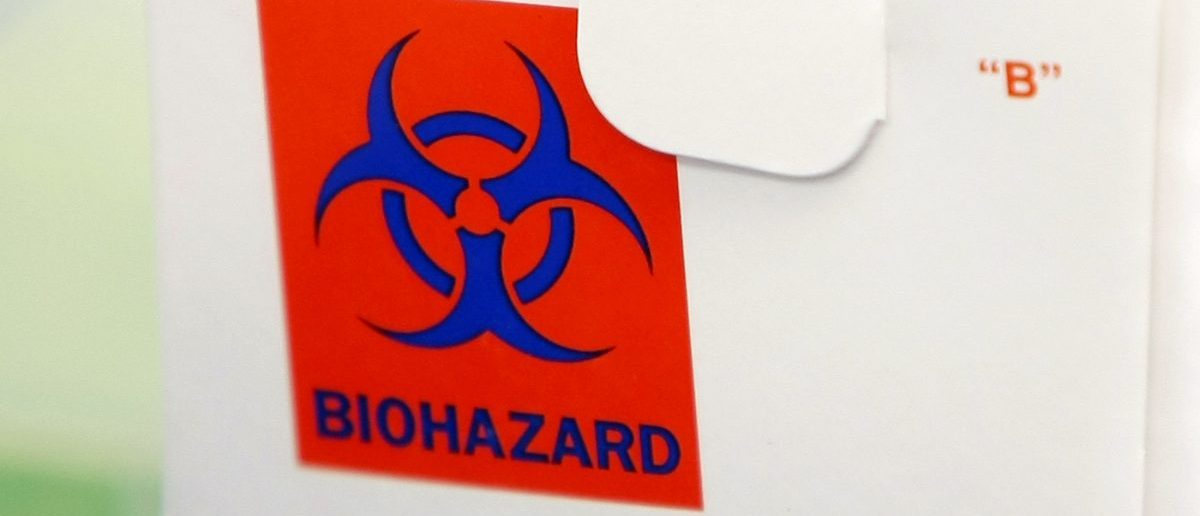 A biohazard sign on a sample box is seen at the County of San Diego Health and Services Agency in San Diego, California April 26, 2009. The United States declared a public health emergency on Sunday because of an outbreak of swine flu that has been diagnosed in 20 people in this country -- the same strain suspected of killing 81 people in Mexico. REUTERS/MikeBlake