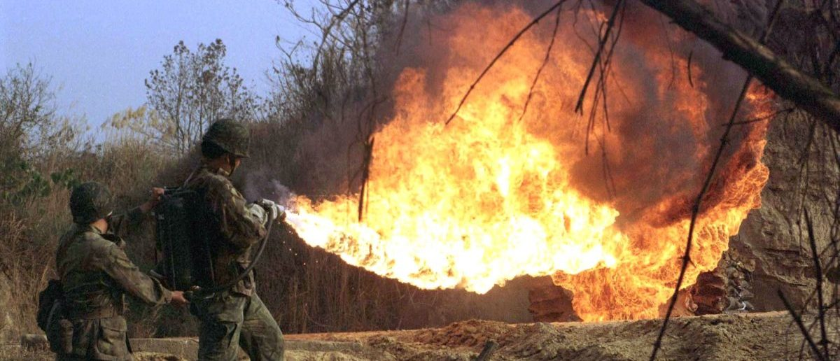 Soldiers use flamethrowers during a practice drill at a military base in the southern county of Chiayi January 30. The armed forces here usually step up training before the Chinese lunar new year which falls on February 7 to increase their combat readiness. lc/Photo by C.C.