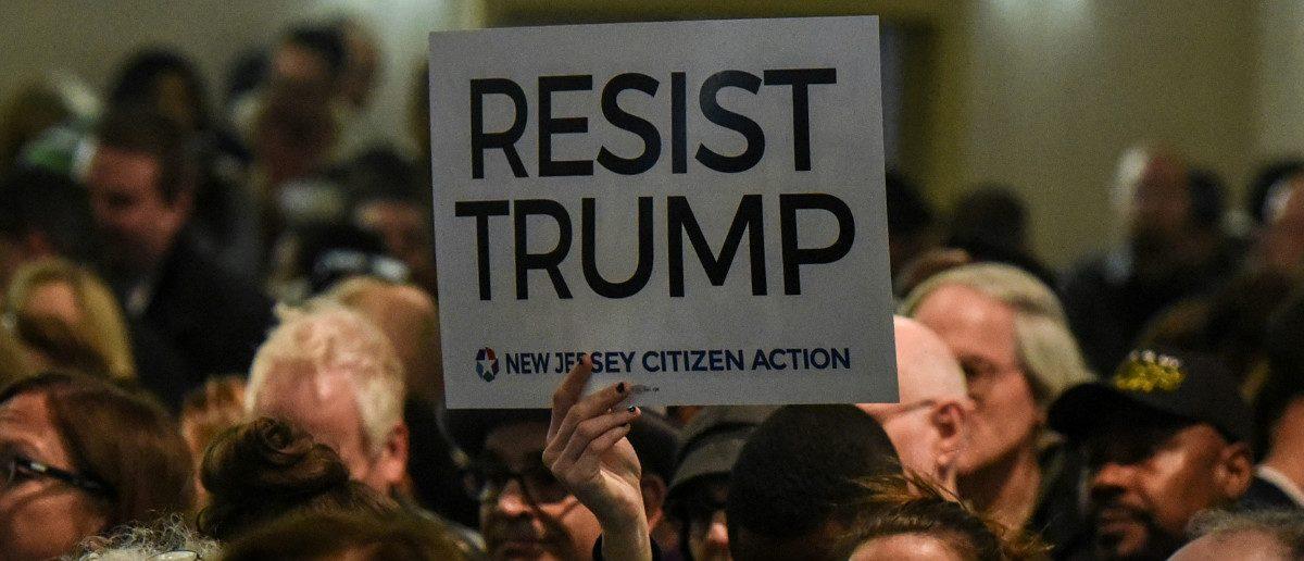 Resist Trump Sign: REUTERS/Stephanie Keith