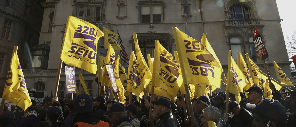 Members of the Service Employees International Union (SEIU) march during a protest in support of a new contract for apartment building workers in New York City, April 2, 2014. REUTERS/Mike Segar/File Photo