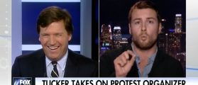 Tucker Debates Anti-Trump Protester — 'As A Gay Man' What Scares You About Trump? [VIDEO]