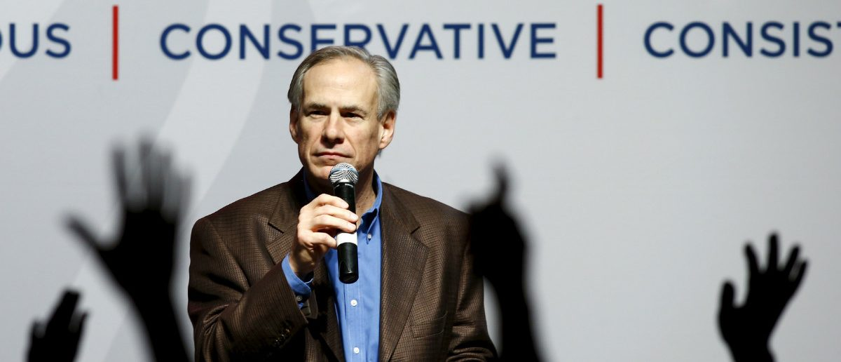 Texas Governor Greg Abbott speaks at a campaign rally for U.S. Republican presidential candidate Ted Cruz in Dallas, Texas February 29, 2016. REUTERS/Mike Stone/File Photo