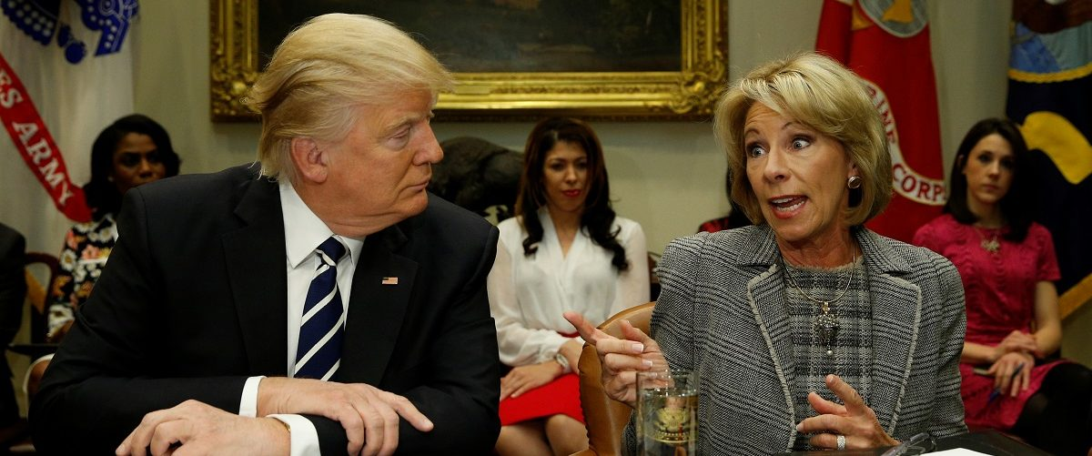U.S. President Donald Trump listens to U.S. Secretary of Education Betsy DeVos speak at meeting with teachers and parents at the White House in Washington, U.S., February 14, 2017.  REUTERS/Kevin Lamarque.