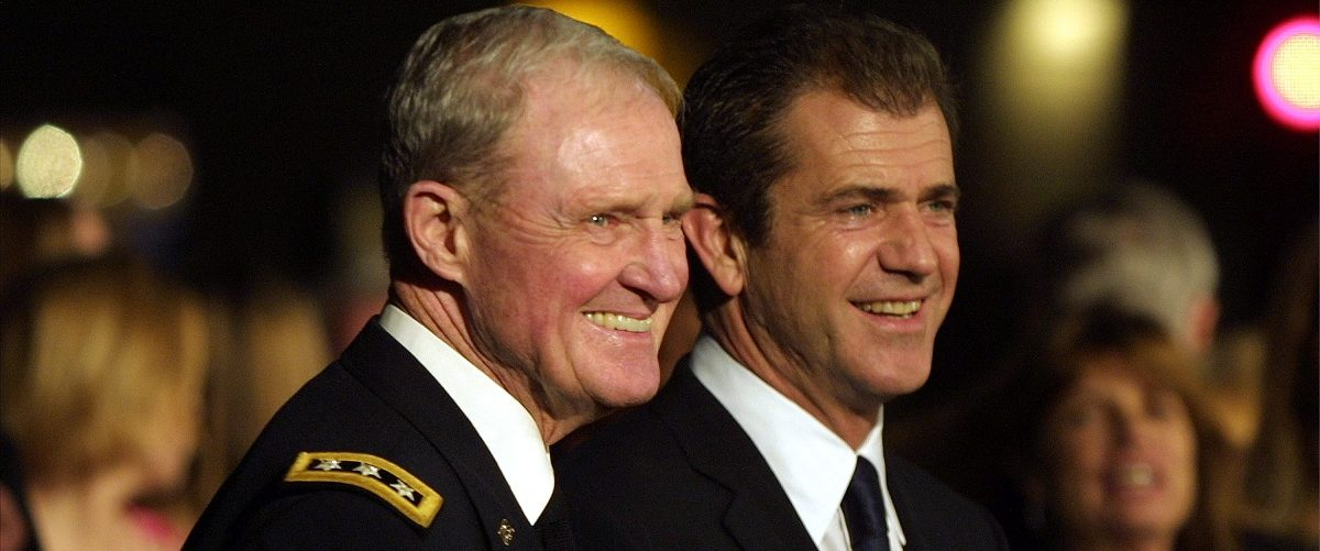 """Actor Mel Gibson and Hal Moore arrive at the premiere of the movie """"We Were Soldiers"""" February 25, 2002 in Westwood, CA. J. Emilio Flores/Getty Images."""