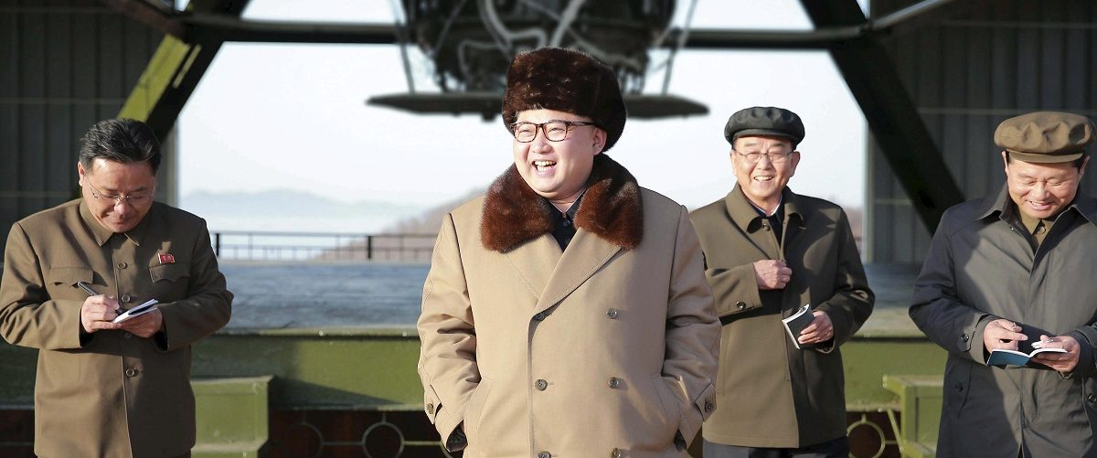 North Korea leader Kim Jong Un smiles as he visits Sohae Space Center for the testing of a new engine for an ICBM