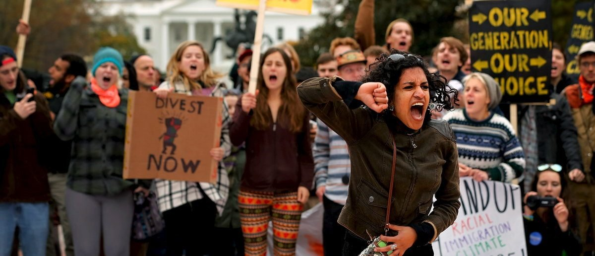 "Varshini Prakash of the Divestment Student Network leads chants of ""I believe that we will win"" during the 'Our Generation, Our Choice' protest near the White House in downtown Washington November 9, 2015. The Monday march to highlight race, climate, and immigration issues was timed to mark exactly one year until the 2016 U.S. presidential election, according to protesters. (REUTERS/Jonathan Ernst)"