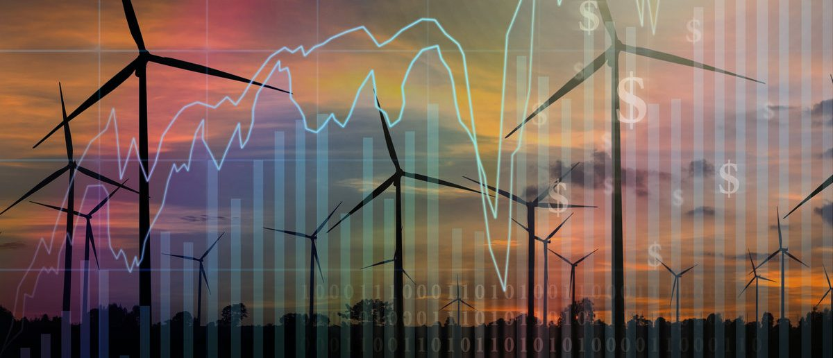 Trading graph on Wind turbine power generator at twilight time background,Business financial concept (Shutterstock/TZIDO SUN)
