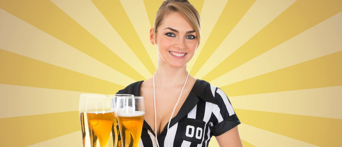 Portrait Of A Young Female Referee Holding Tray With Beer  (Shutterstock/Andrey_Popov)