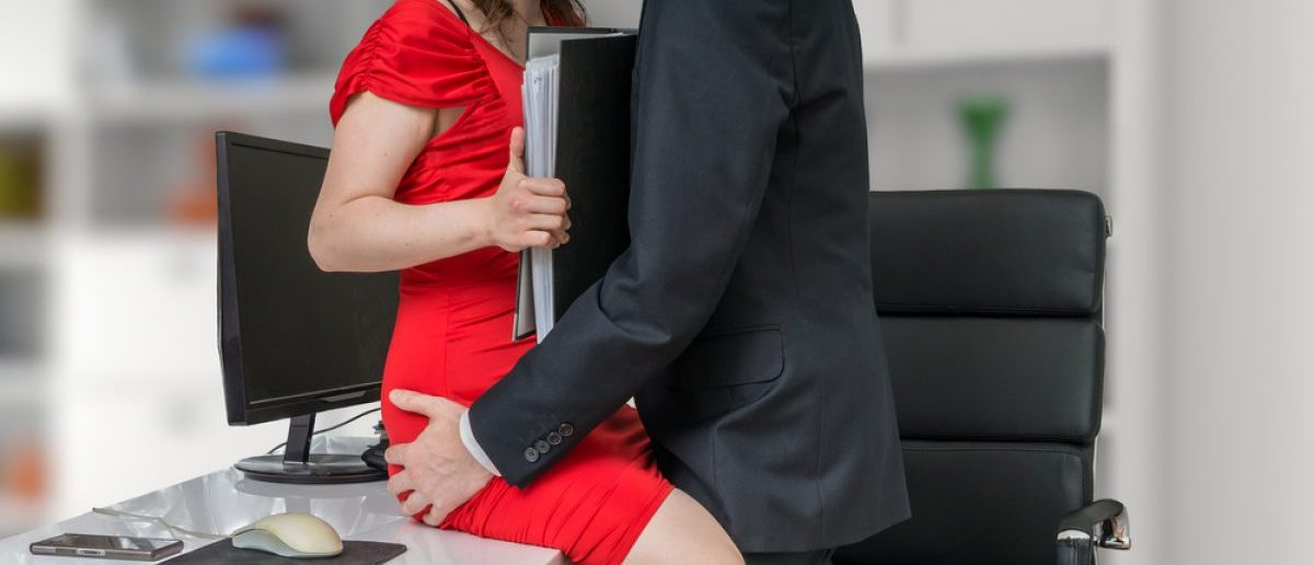 A superior being highly inappropriate with a secretary at work. [Shutterstock - vchal]