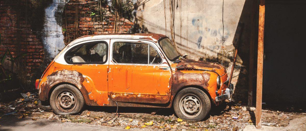 Old beat-up vintage car. [Shutterstock - LennonLand]