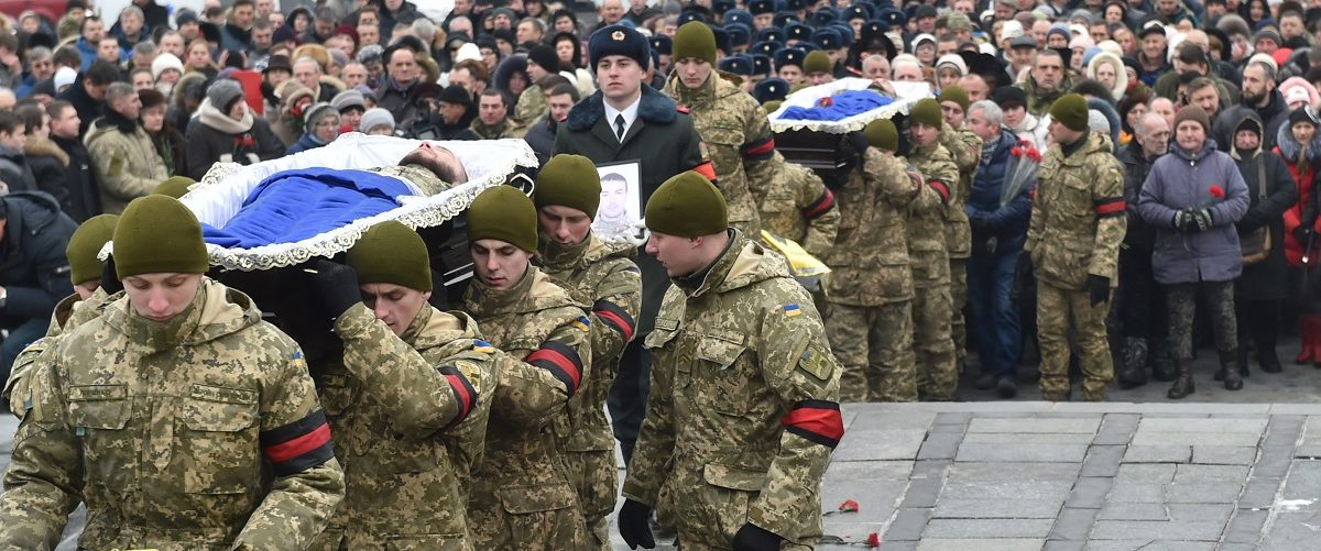 Servicemen carry the coffins with the bodies of Ukrainian soldiers who died during fighting in the eastern Ukrainian town of Avdiivka, during a mourning ceremony on Independence Square in Kiev on February 1, 2017. The death toll from the latest escalation in fighting in Ukraine rose to 16 as international alarm rang out over the spike in bloodshed in the European Union's back yard. Government forces and pro-Russian separatists exchanged mortar and grenade fire for a fourth day around the flashpoint town of Avdiivka that sits just north of the rebels' de facto capital Donetsk in eastern Ukraine. Sergei/Supinsky/AFP/Getty Images.