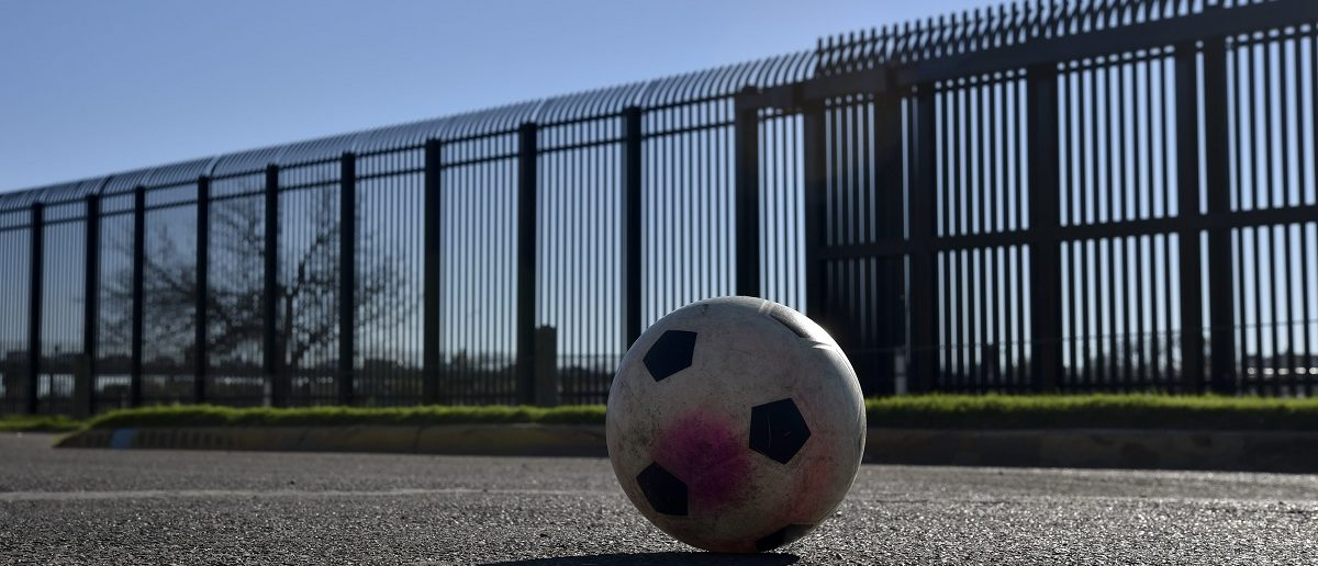 A soccer ball remains in a street in front of metal wall in the border between US and Mexico in Eagle Pass, US on February  21, 2017. Yuri Cortez/AFP/Getty Images.