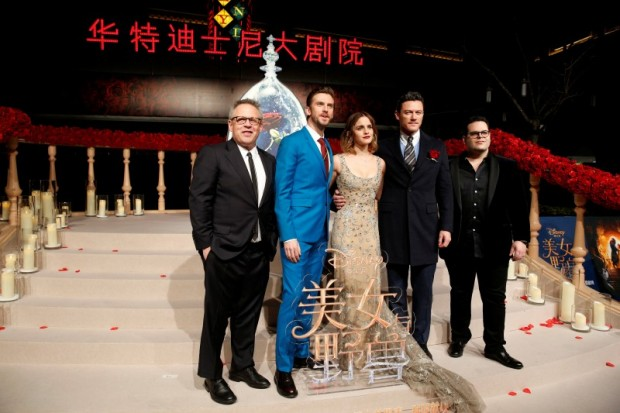 """Director Bill Condon and actors Dan Stevens, Emma Watson, Luke Evans, and Josh Gad (L-R) pose for photographers on the red carpet for the film """"Beauty and the Beast"""" in Shanghai, China February 27, 2017. REUTERS/Aly Song"""