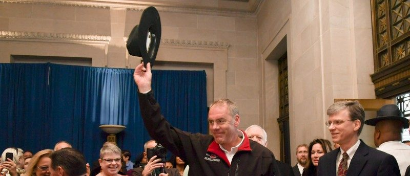 New Interior Secretary Ryan Zinke tips his cowboy hat after riding in on horseback with a U.S. Park Police horse mounted unit reporting for his first day of work at the Interior Department in Washington, U.S., March 2, 2017. Tami Heilemann/Department of Interior/Handout via REUTERS