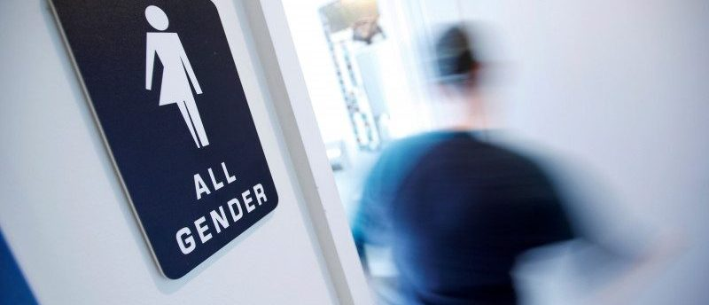 FILE PHOTO - A bathroom sign welcomes both genders at the Cacao Cinnamon coffee shop in Durham, North Carolina, on May 3, 2016.   REUTERS/Jonathan Drake/File Photo