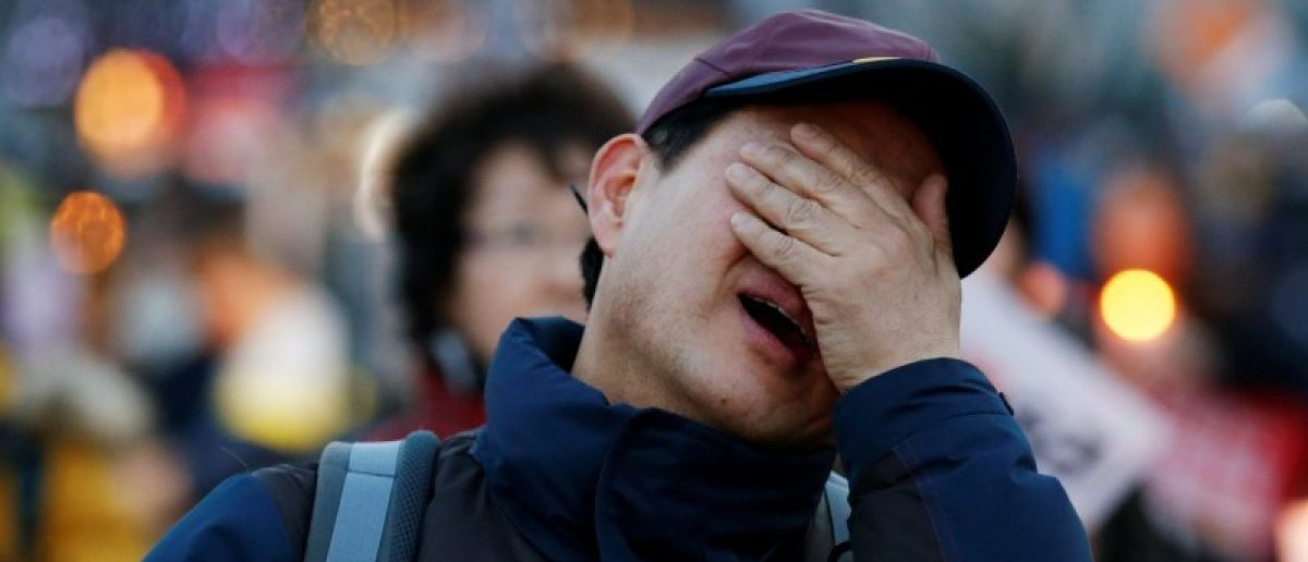 A man cries at a rally celebrating the impeachment of South Korea's ousted leader Park Geun-hye in Seoul, South Korea, March 11, 2017.  REUTERS/Kim Kyung-Hoon
