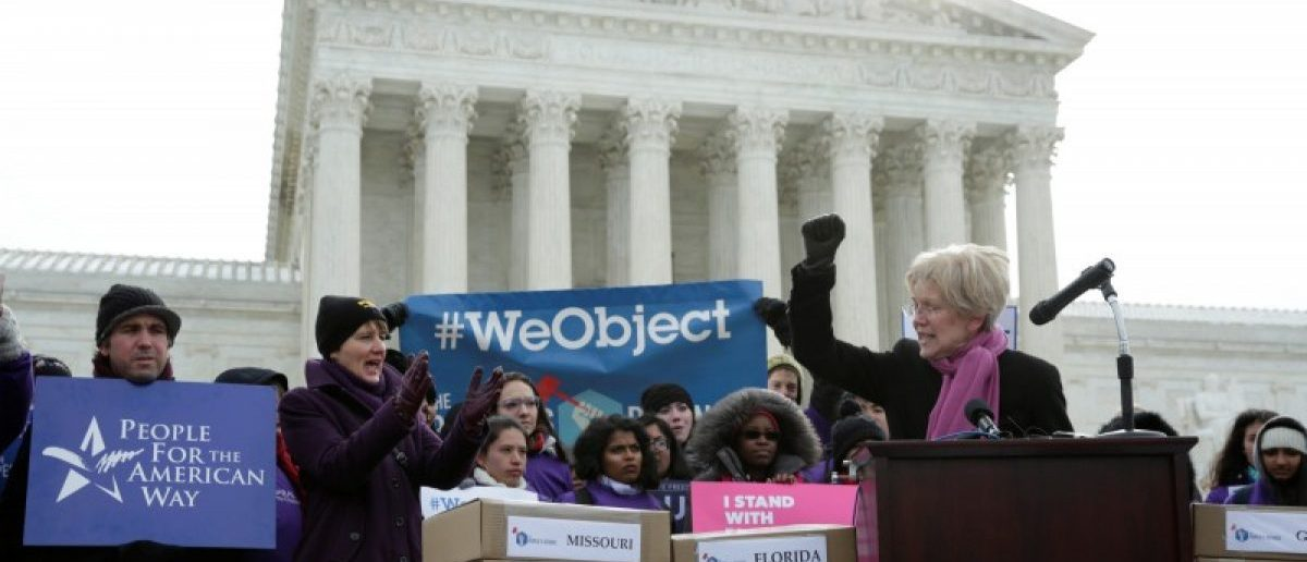 Senator Elizabeth Warren (D-MA) speaks in front of the U.S. Supreme Court to kick off the delivery of petitions calling on senators to oppose Supreme Court nominee Judge Neil Gorsuch in Washington, U.S., March 15, 2017. REUTERS/Yuri Gripas