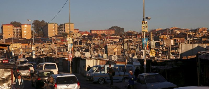 FILE PHOTO: Alexandra Township, an informal settlement for thousands of South Africans who lack the means to get a proper home, South Africa,  July 28, 2016. REUTERS/Siphiwe Sibeko/File Photo