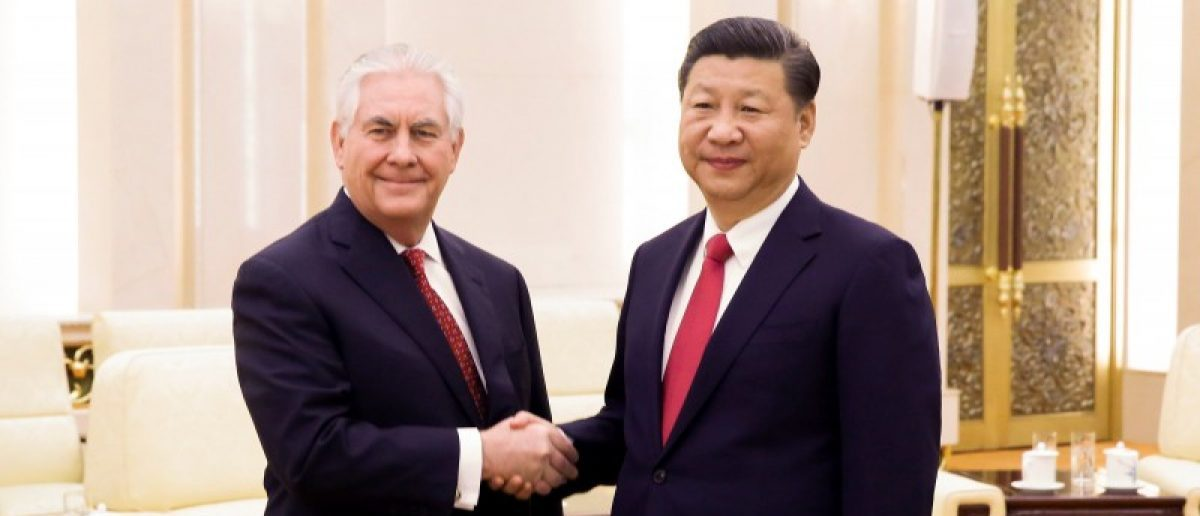 China's President Xi Jinping (R) shakes hands with U.S. State of Secretary, Rex Tillerson at the Great Hall of the People in Beijing, China, March 19, 2017.  REUTERS/Thomas Peter