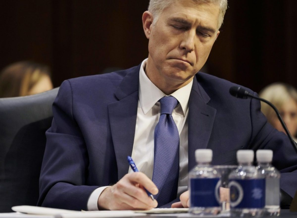 Supreme Court nominee judge Neil Gorsuch takes notes as he testifies at his Senate Judiciary Committee confirmation hearing on Capitol Hill in Washington, U.S., March 20, 2017. REUTERS/James Lawler Duggan