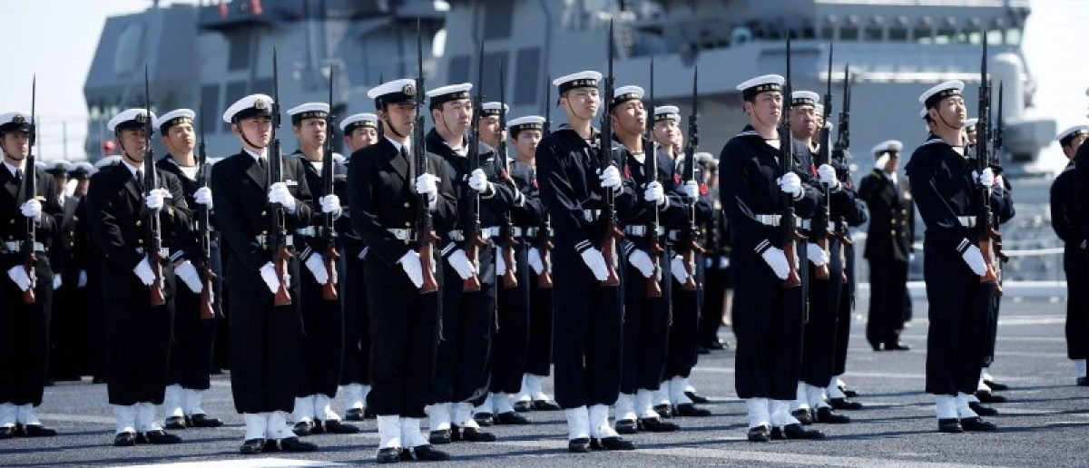 Members of the Japan Maritime Self-Defense Force (JMSDF) attend a handover ceremony for the JMSDF latest Izumo-class helicopter carrier DDH-184 Kaga by Japan Marine United Corporation in Yokohama, Japan, March 22, 2017. REUTERS/Toru Hanai