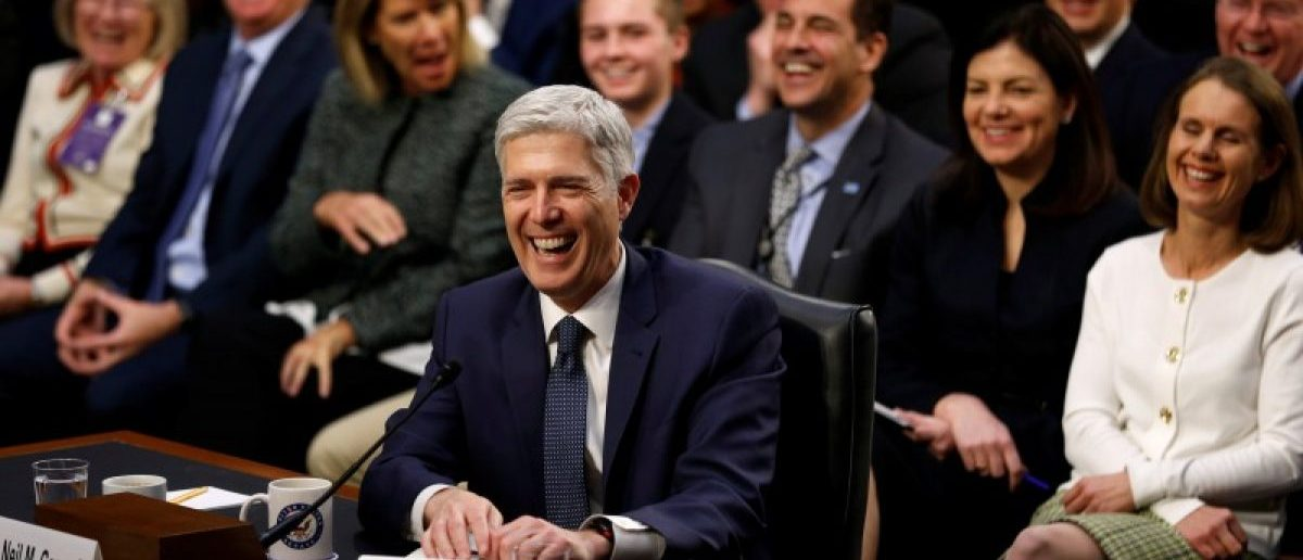 "Supreme Court nominee judge Neil Gorsuch and his supporters seated behind him erupt in laughter after he accidentally used the word ""bigly"" during the third day of his Senate Judiciary Committee confirmation hearing on Capitol Hill in Washington, U.S., March 22, 2017. REUTERS/Jonathan Ernst"