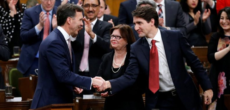 Canada's Prime Minister Justin Trudeau (R) shakes hands with Finance Minister Bill Morneau after Morneau delivered the federal budget in the House of Commons on Parliament Hill in Ottawa, Ontario, Canada, March 22, 2017. REUTERS/Chris Wattie