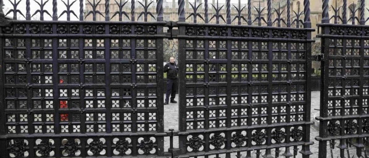 A police officer stands behind Carriage Gates at the Houses of Parliament, following a recent attack in Westminster, London, Britain March 24, 2017. REUTERS/Darren Staples