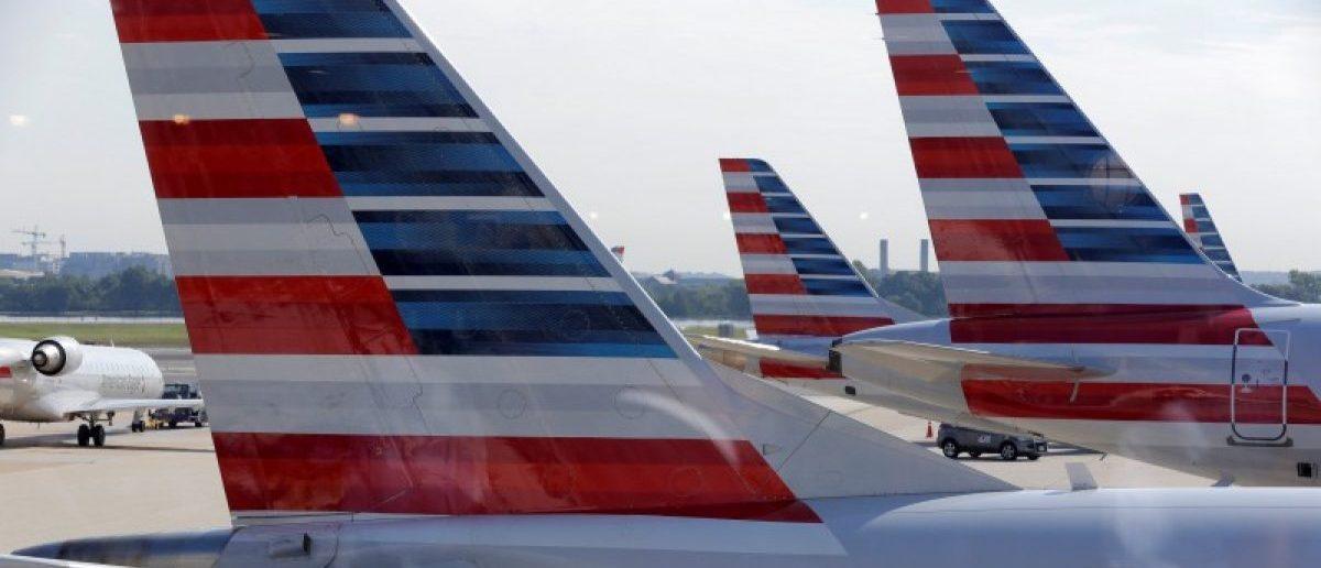 busiFILE PHOTO: American Airlines aircraft are parked at Ronald Reagan Washington National Airport in Washington.