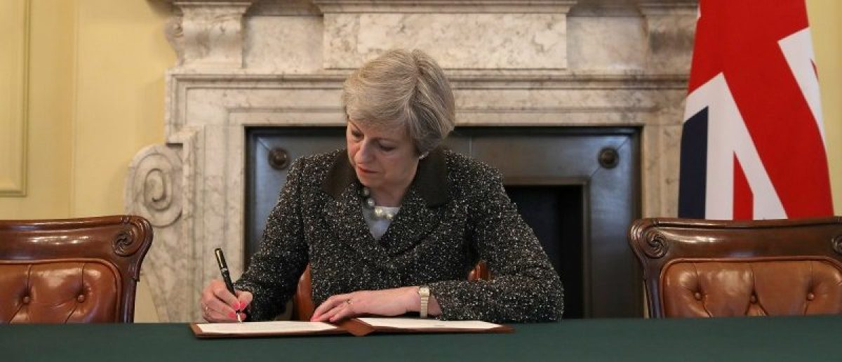 British Prime Minister Theresa May in the cabinet office signs the official letter to European Council President Donald Tusk invoking Article 50 and the United Kingdom's intention to leave the EU on March 28, 2017 in London, England. After holding a referendum in June 2016 the United Kingdom voted to leave the European Union, the signing of Article 50 now officially triggers that process. REUTERS/Christopher Furlong/Pool