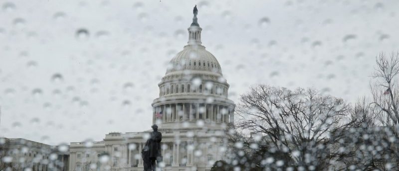 FILE PHOTO: The U.S. Capitol building is seen in the rain as the U.S. House of Representatives prepare for a planned vote on the American Health Care Act, promoted by House Republicans and the Trump administration to repeal and replace the Affordable Care Act act known as Obamacare, on Capitol Hill in Washington, U.S., March 24, 2017. REUTERS/Jim Bourg