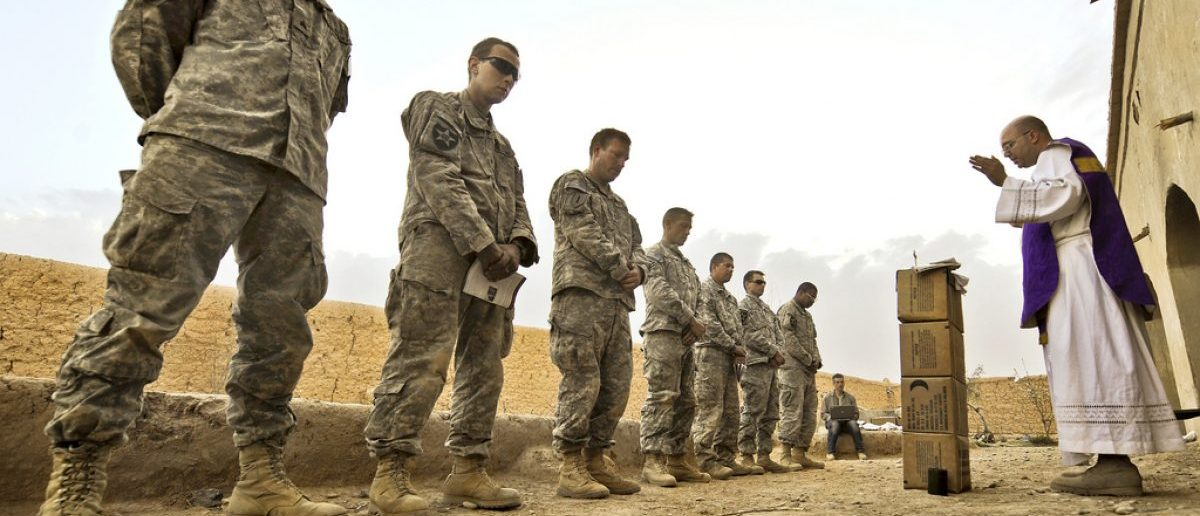 U.S. Army Capt. Carl Subler, right, a chaplain, delivers a Catholic mass to Soldiers from Alpha Company, 1st Battalion, 17th Infantry Regiment at an abandoned compound during Operation Moshtarak in Badula Qulp, Helmand province, Afghanistan, Feb. 21, 2010. (U.S. Air Force photo by Tech. Sgt. Efren Lopez/Released)