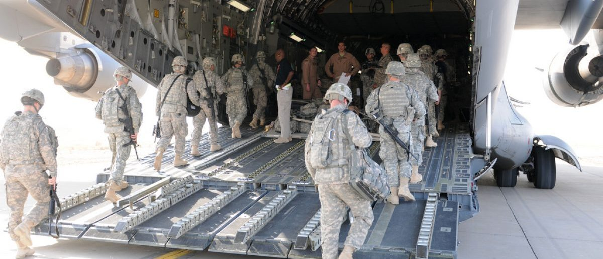 The flight crew of a C-17 oversees the boarding of soldiers from 3rd Infantry Division at Contingency Operating Base Speicher, Iraq, Aug. 23. These Dog Face soldiers are among the first to leave under the responsible drawdown of forces. (U.S. Army photo by Sgt. Ry Norris)