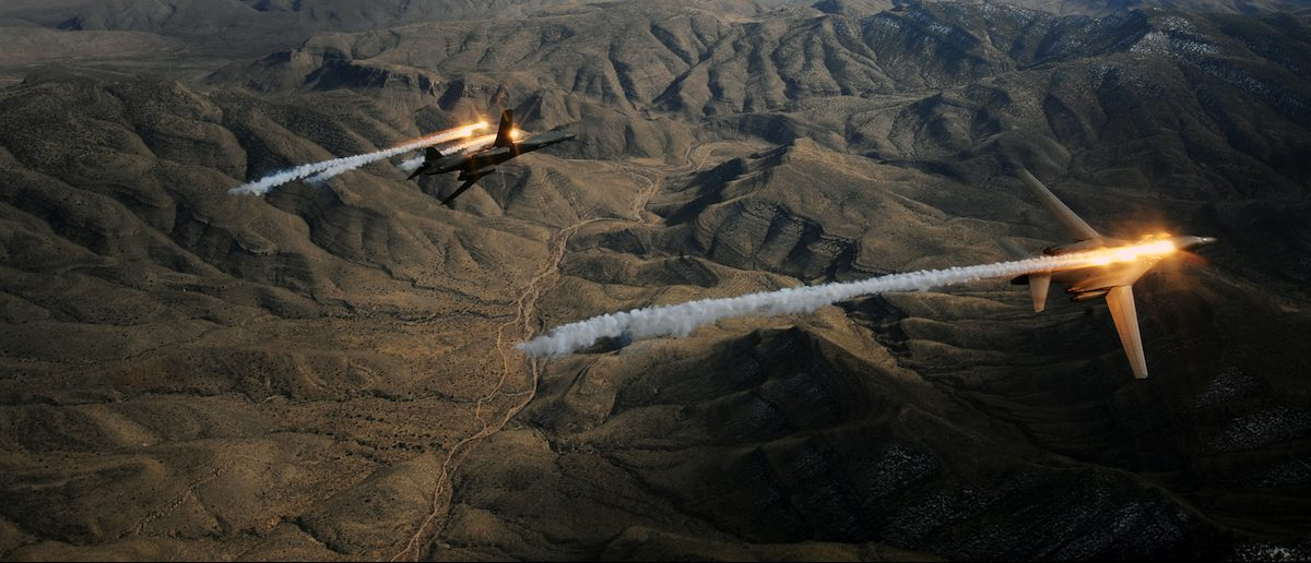 A two-ship of B-1B Lancers assigned to the 28th Bomb Squadron, Dyess Air Force Base, Texas, release chaff and flares while maneuvering over New Mexico during a training mission Feb. 24, 2010. Dyess celebrates the 25th anniversary of the first B-1B bomber arriving at the base. (U.S. Air Force photo/ Master Sgt. Kevin J. Gruenwald)