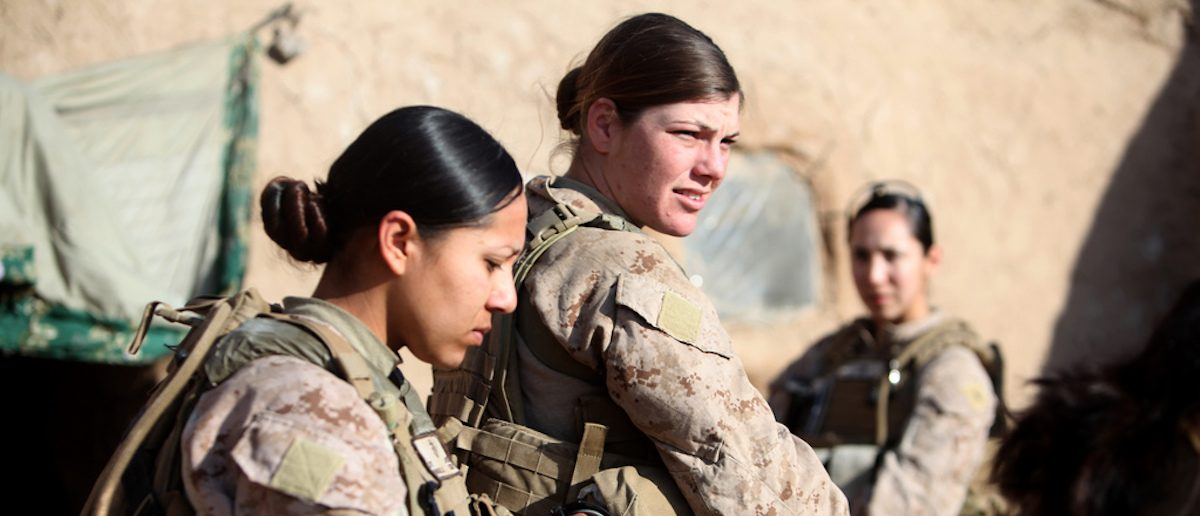 U.S. Marine Corps Sgt. Jessica Domingo, right, and Cpl. Daisy Romero, assigned to a female engagement team (FET), speak with an Afghan man in his compound during a patrol in Marjah, Helmand province, Afghanistan, Dec. 30, 2010. The FET worked with infantry Marines by engaging women and children in support of the International Security Assistance Force. (U.S. Marine Corps photo by Cpl. Marionne T. Mangrum/Released)