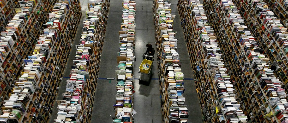 A worker gathers items for delivery from the warehouse floor at Amazon's distribution center in Phoenix, Arizona. (REUTERS/Ralph D. Freso.)