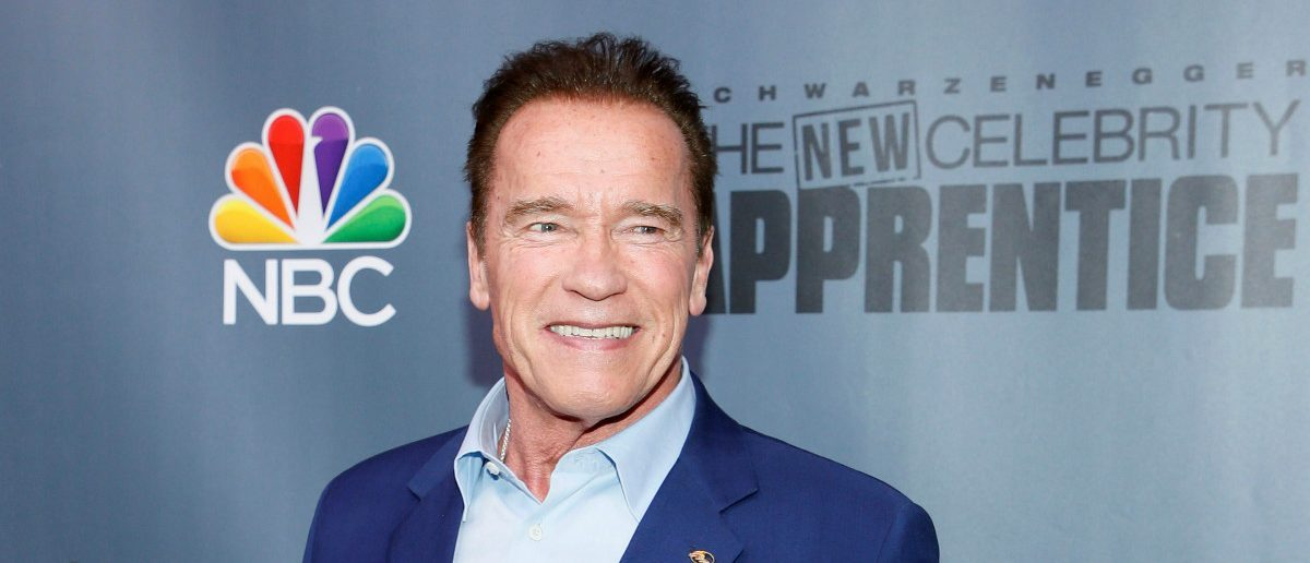 """Host Arnold Schwarzenegger poses after a panel for """"The New Celebrity Apprentice"""" in Universal City, California, December 9, 2016. REUTERS/Danny Moloshok"""