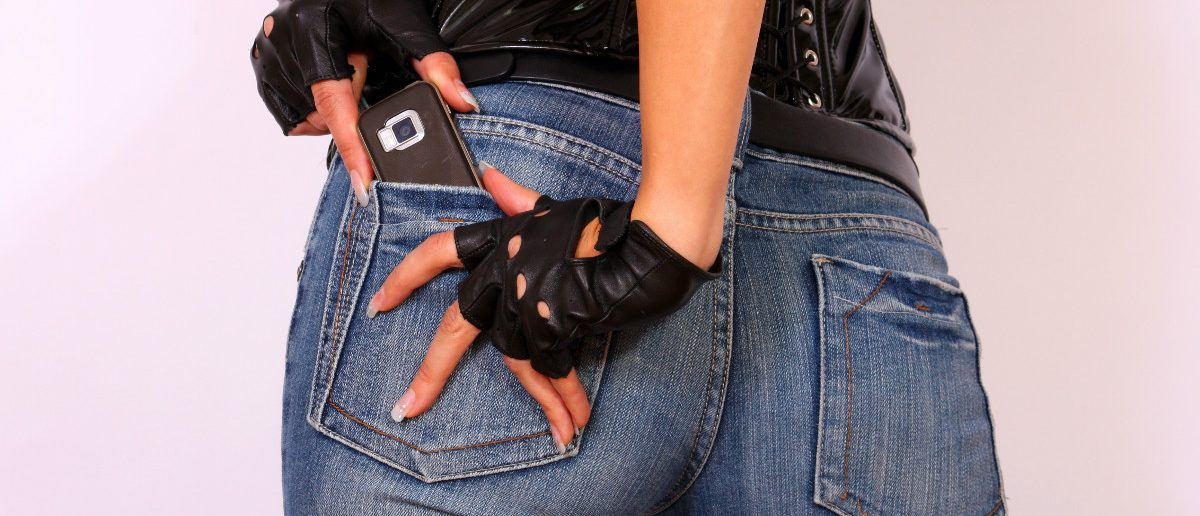 Young Woman With Cell Phone In Her Pocket: Dukibu/Shutterstock