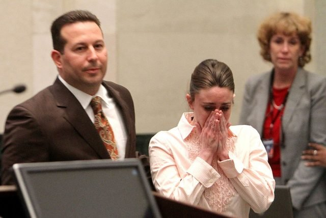 Casey Anthony reacts to being found not guilty on murder charges as she stands next to her attorney Jose Baez at the Orange County Courthouse on July 5, 2011 in Orlando, Florida. Casey Anthony had been accused of murdering her two-year-old daughter Caylee in 2008 and was found not guilty of manslaughter in the first degree. (Photo by Red Huber-Pool/Getty Images)
