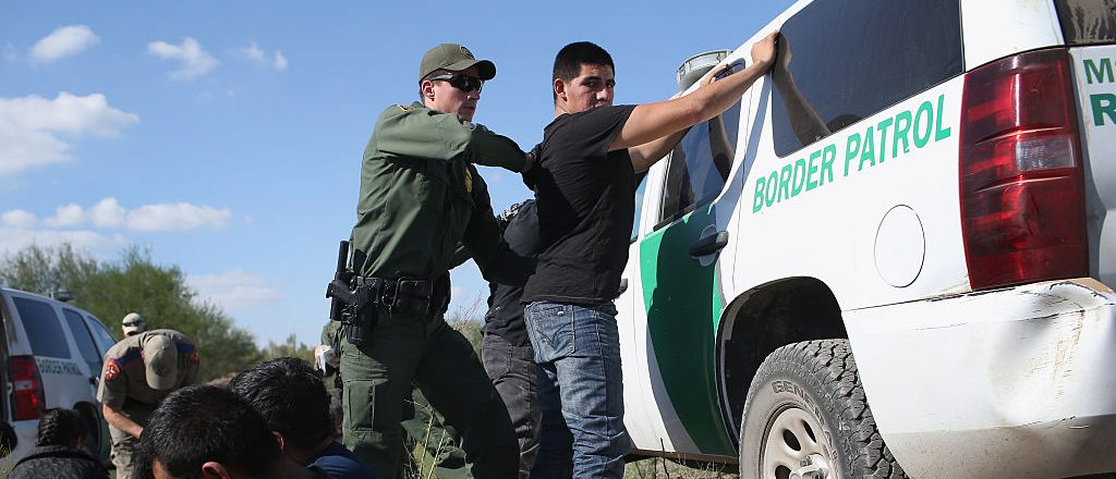 RIO GRANDE CITY, TX - DECEMBER 07:  A U.S. Border Patrol officer body searches an undocumented immigrant after he illegally crossed the U.S.-Mexico border and was caught on December 7, 2015 near Rio Grande City, Texas. Border Patrol agents continue to detain hundreds of thousands of undocumented immigrants trying to avoid capture after crossing into the United States, even as migrant families and unaccompanied minors from Central America cross and turn themselves in to seek assylum.  (Photo by John Moore/Getty Images)