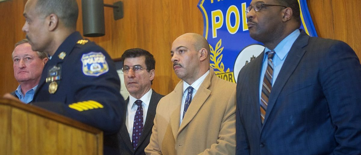 "PHILADELPHIA, PA - JANUARY 8: (C) District Attorney of the city of Philadelphia Rufus Seth Williams listens to Philadelphia Police Commissioner Richard Ross address media at a press conference regarding the shooting of Police Officer Jesse Hartnett, 33, who was ambushed and allegedly shot at 13 times by Edward Archer, 30, last night on January 8, 2016 in Philadelphia, Pennsylvania. Surveillance footage reveals the suspect was dressed in Muslim clothing and wearing a mask. Following his arrest, suspect Edward Archer stated, ""I follow Allah and pledge allegiance to the Islamic State and that is the reason I did what I did."" (Photo by Mark Makela/Getty Images)"