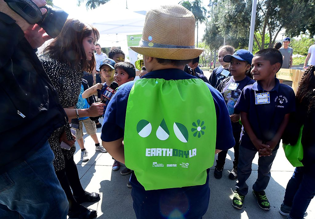 Children are interviewed by news media as elementary schoolchildren attend the Grand Park Earth Day celebration in downtown Los Angeles, California on April 22, 2016. Founded in 1970 as a day of education about environmental issues, Earth Day is now globally celebrated. FREDERIC J. BROWN/AFP/Getty Images
