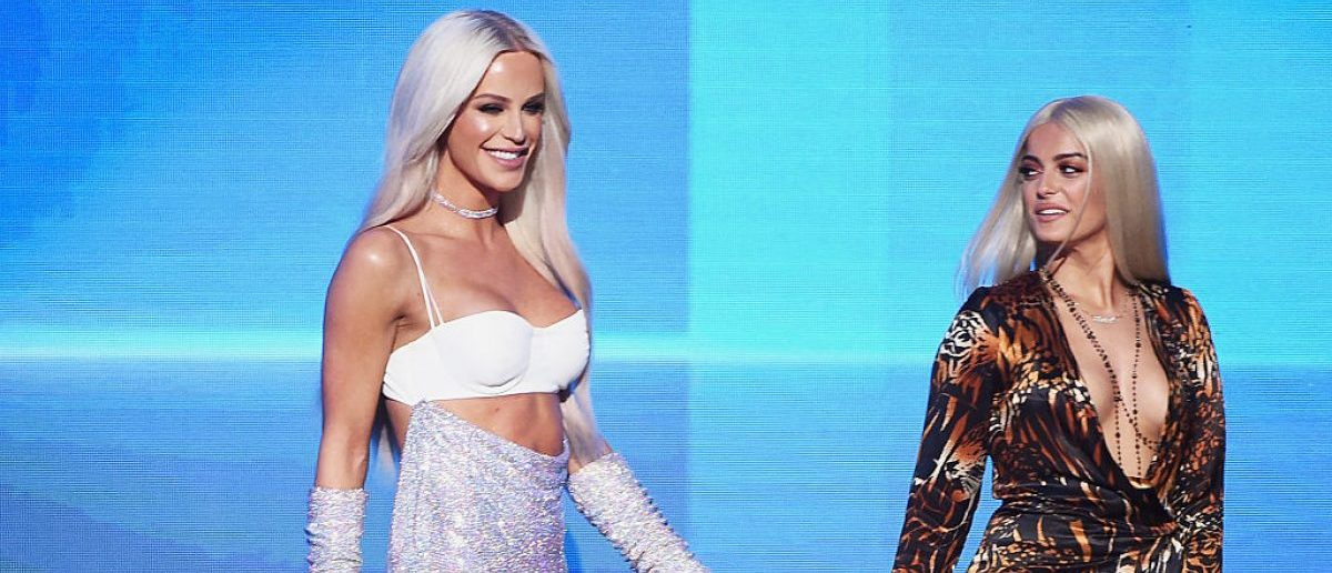 LOS ANGELES, CA - NOVEMBER 20:  Internet personality Gigi Gorgeous (L) and singer Bebe Rexha speak onstage during the 2016 American Music Awards at Microsoft Theater on November 20, 2016 in Los Angeles, California.  (Photo by Kevin Winter/Getty Images)