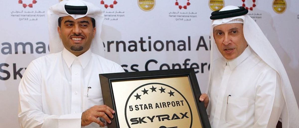 "Hamad International Airport's chief operating officer, Badr al-Meer (L), and Qatar Airways chief executive, Akbar al-Baker, pose for a picture during a ceremony which crowned Doha's Hamad International as a ""five-star"" airport, one of only six in the world, on January 5, 2017. (Photo credit: STRINGER/AFP/Getty Images)"